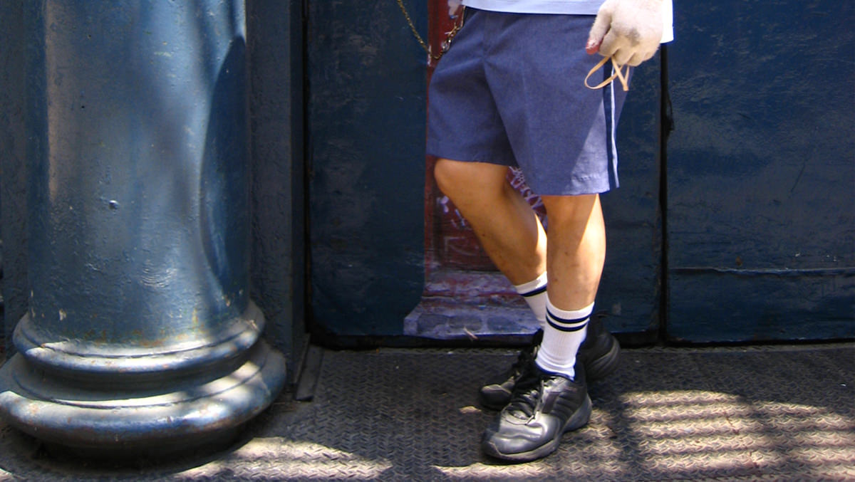 A mailman wearing shorts