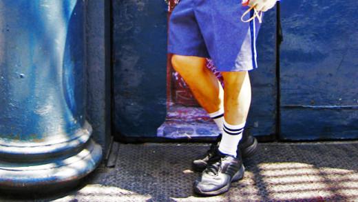 Mailman wearing shorts